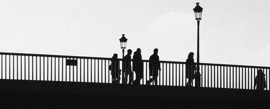 A group crossing a bridge in Paris during a walking guided tour